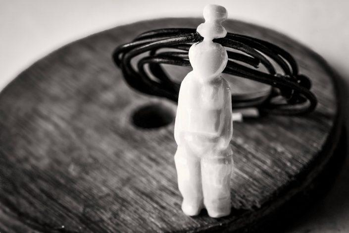 A figurine in a necklace from Tasiilaq in East Greenland - by Mads Pihl