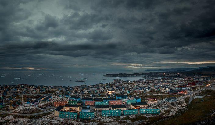 A night time view of Ilulissat in Greenland. Photo by Mads Pihl - Visit Greenland
