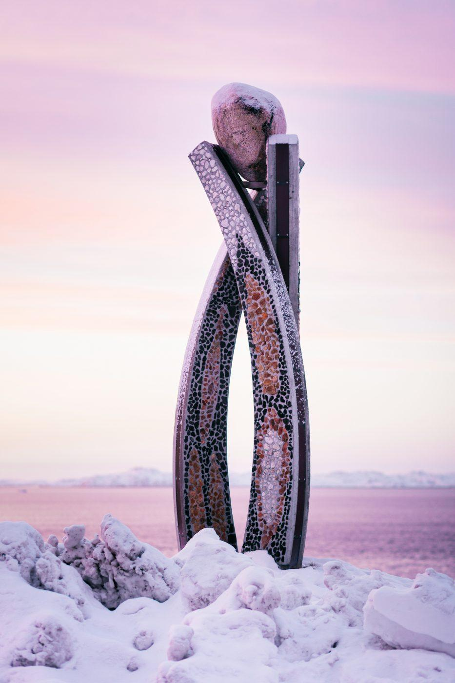 The sculpture Inussuk by Niels Motzfeldt on a winter afternoon in Nuuk in Greenland. by Rebecca Gustafsson - Visit Greenland