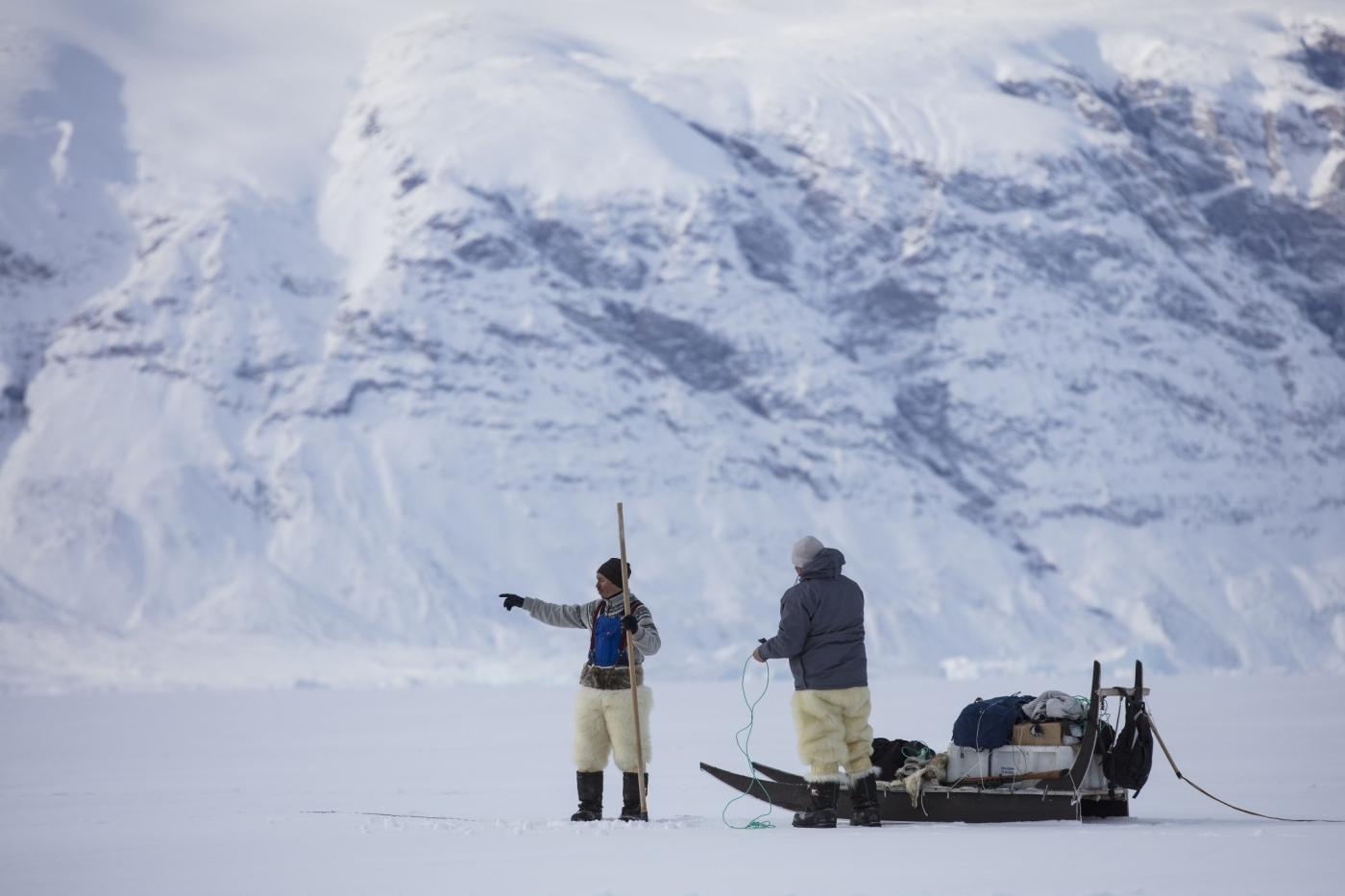 Two guides doing a pit stop on the dogsledding excursion. Photo by Greenland Fiord Tours