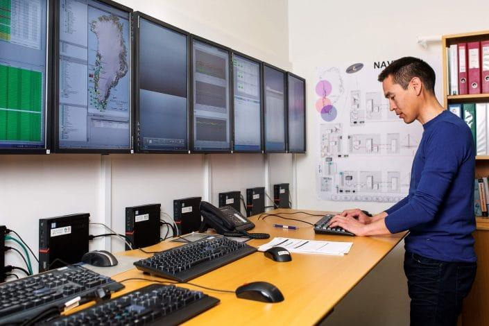 Focused Tele-Post's employee using monitoring tools at the operating office in Nuuk . Photo by Filip Gielda