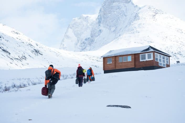 Skiers arrive to their cabin in Qooqqut to start a ski weekend. By Petter Cohen, Xtravel