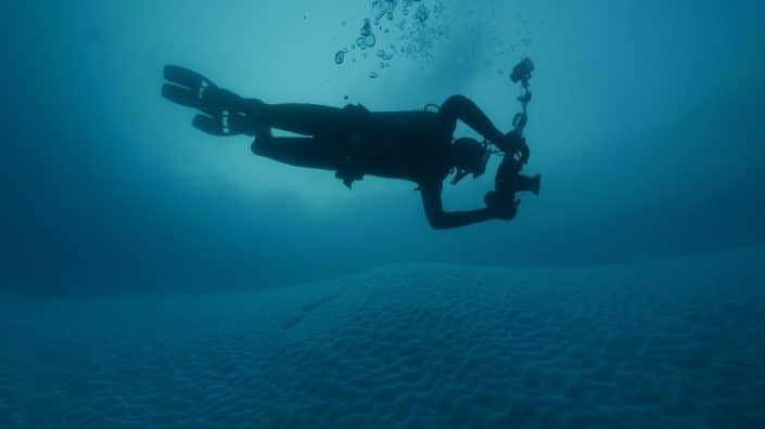 Kingsley Griffin exploring the underside of the giant iceberg.