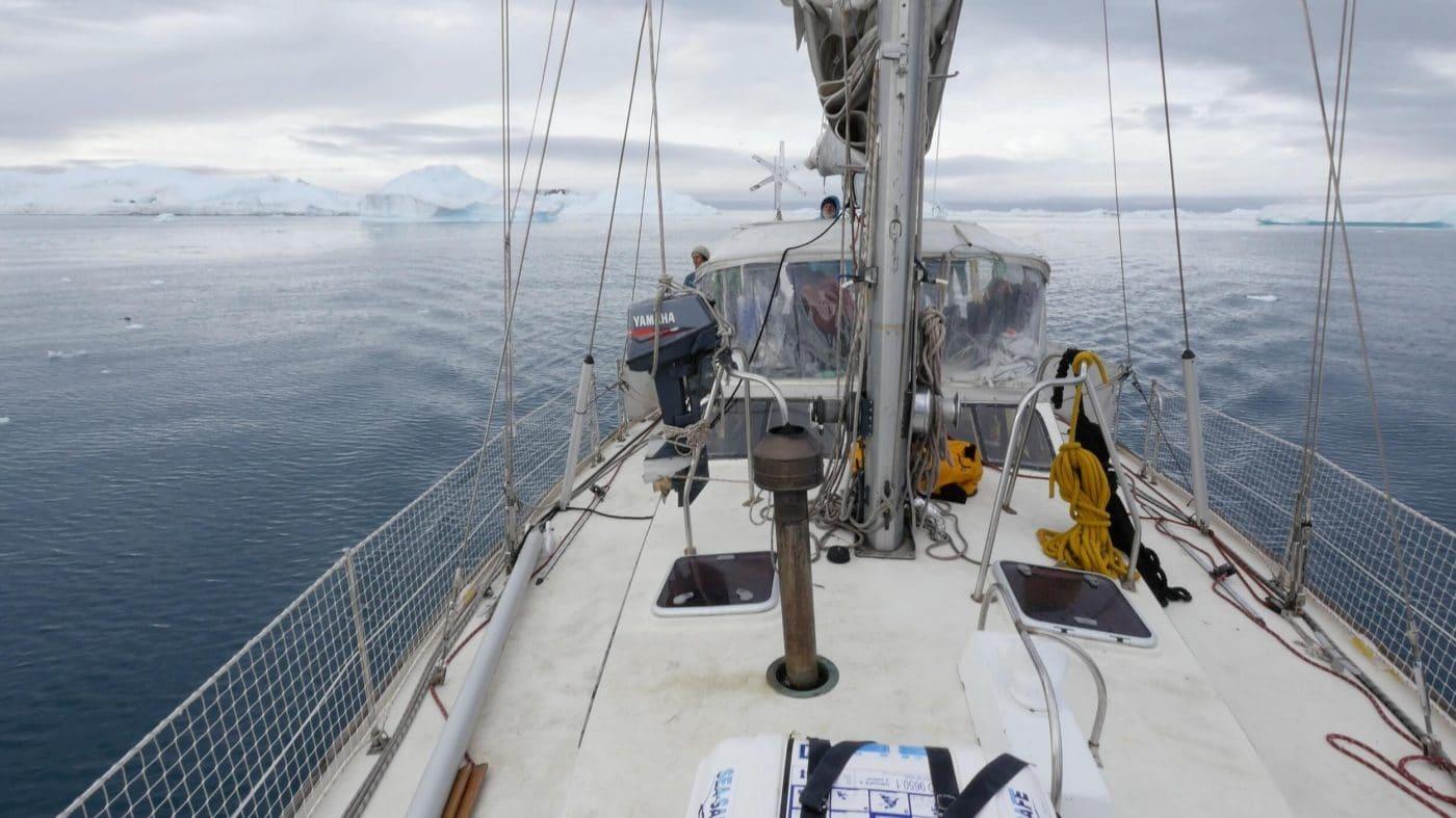 Our captain Olivier Huin steers handmade wooden boat Breskell down the Kangerlussuaq channel.jpg