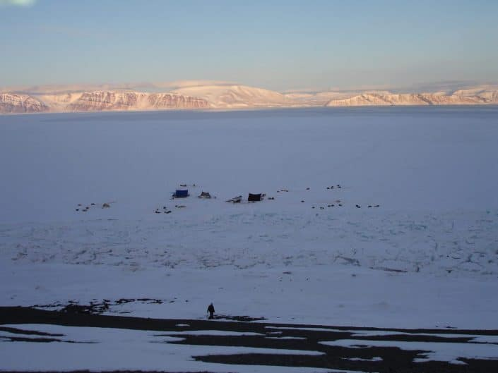 Man walking in backcountry of Qaanaaq towards hunting camp on ice in Winter. Photo by Nunataq Atsuk Travel
