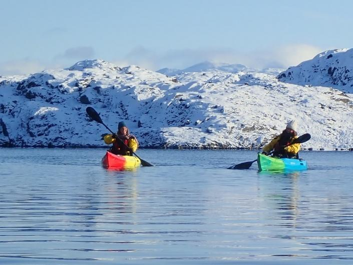 Two men kayaking in the lake. Photo by Nuuk Adventure - Visit Greenland