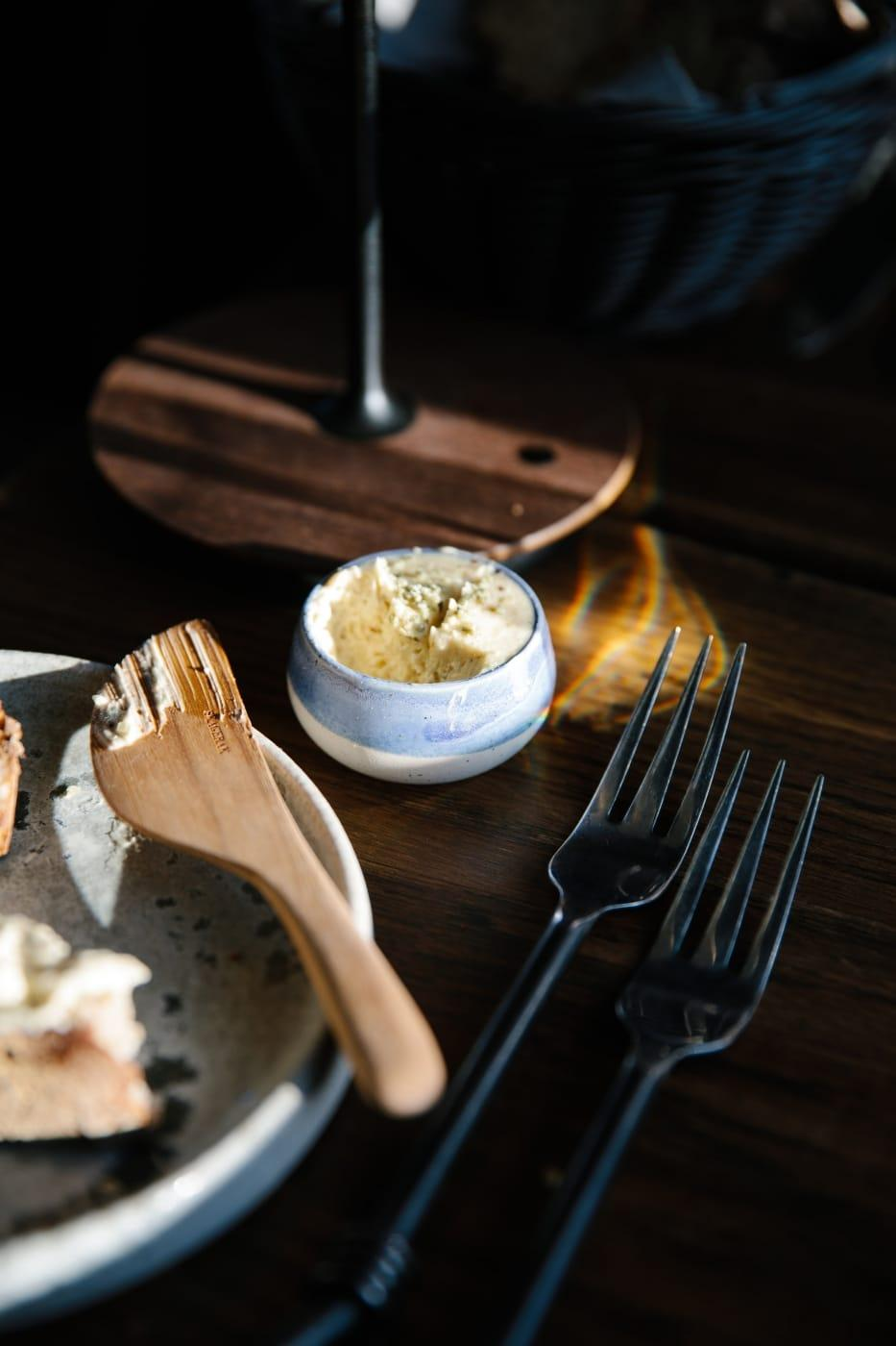 Details while waiting for dinner - homemade butter in the evening light at Ilimanaq restaurant. Photo by Jessie Brinkman Evans