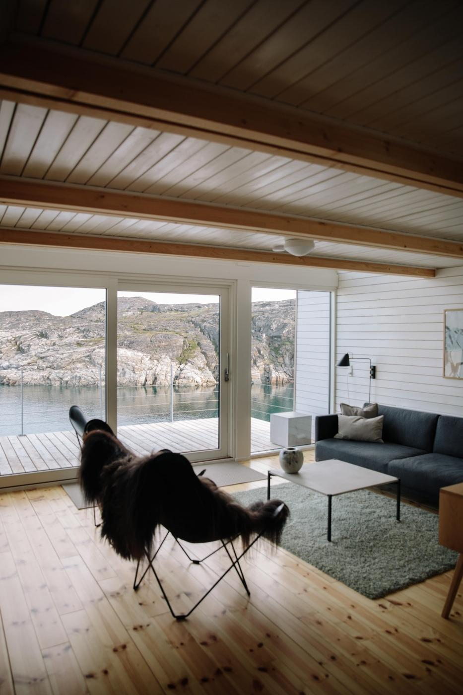 The living room of the hut at Ilimanaq Lodge with ocean views. Photo by Jessie Brinkman Evans
