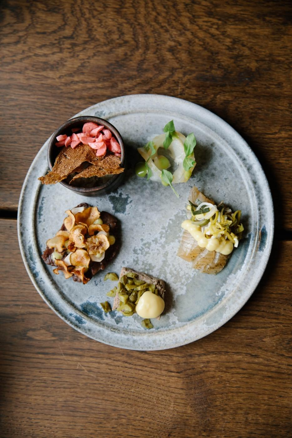 Lunch platter in the Ilimanaq restaurant with wild, foraged ingredients - mushrooms, muskox pate, raw and smoked halibut 2. Photo by Jessie Brinkman Evans