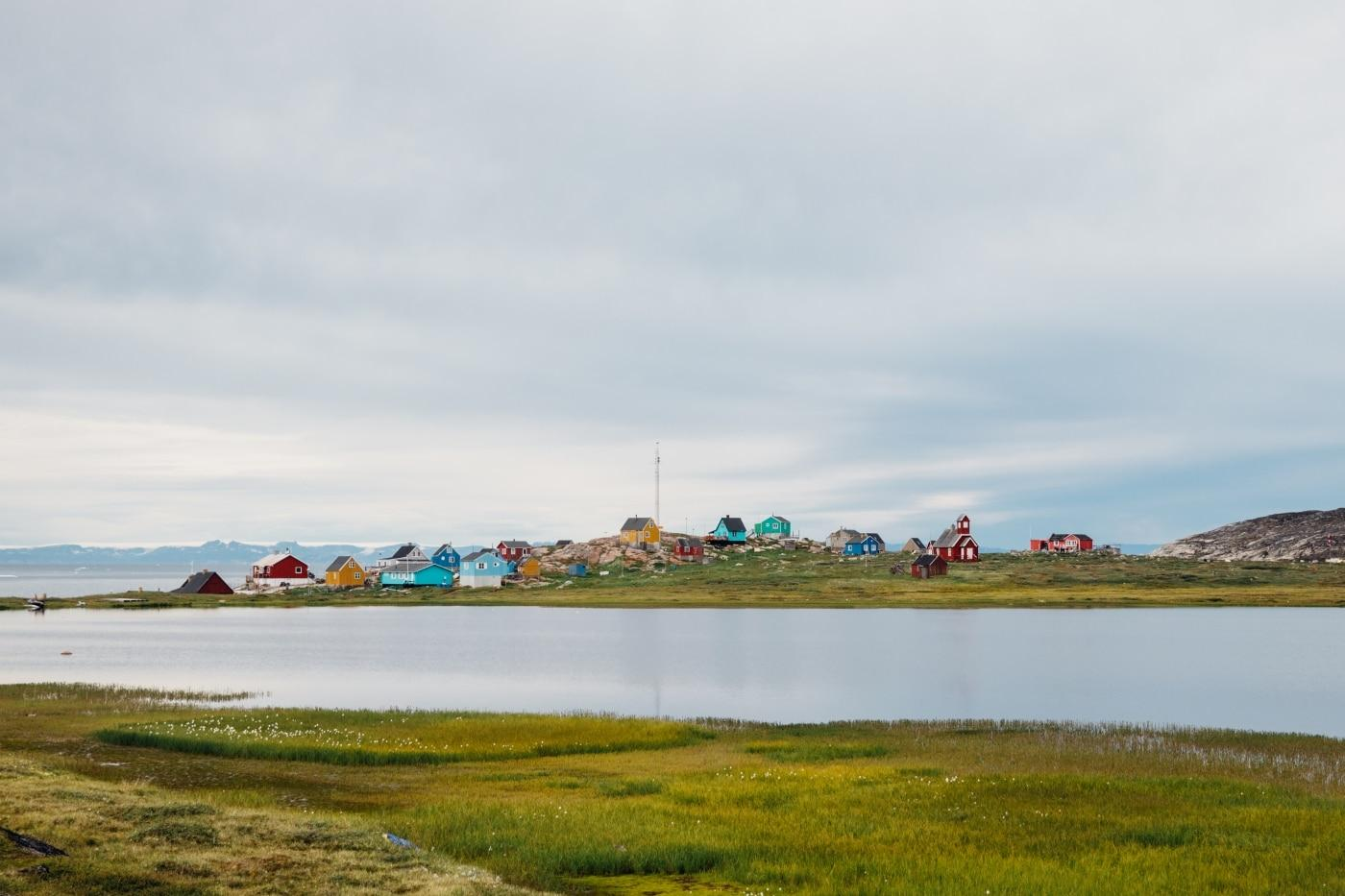 Colourful homes and church in the settlement of Ilimanaq from across the lake 2. Photo by Jessie Brinkman Evans