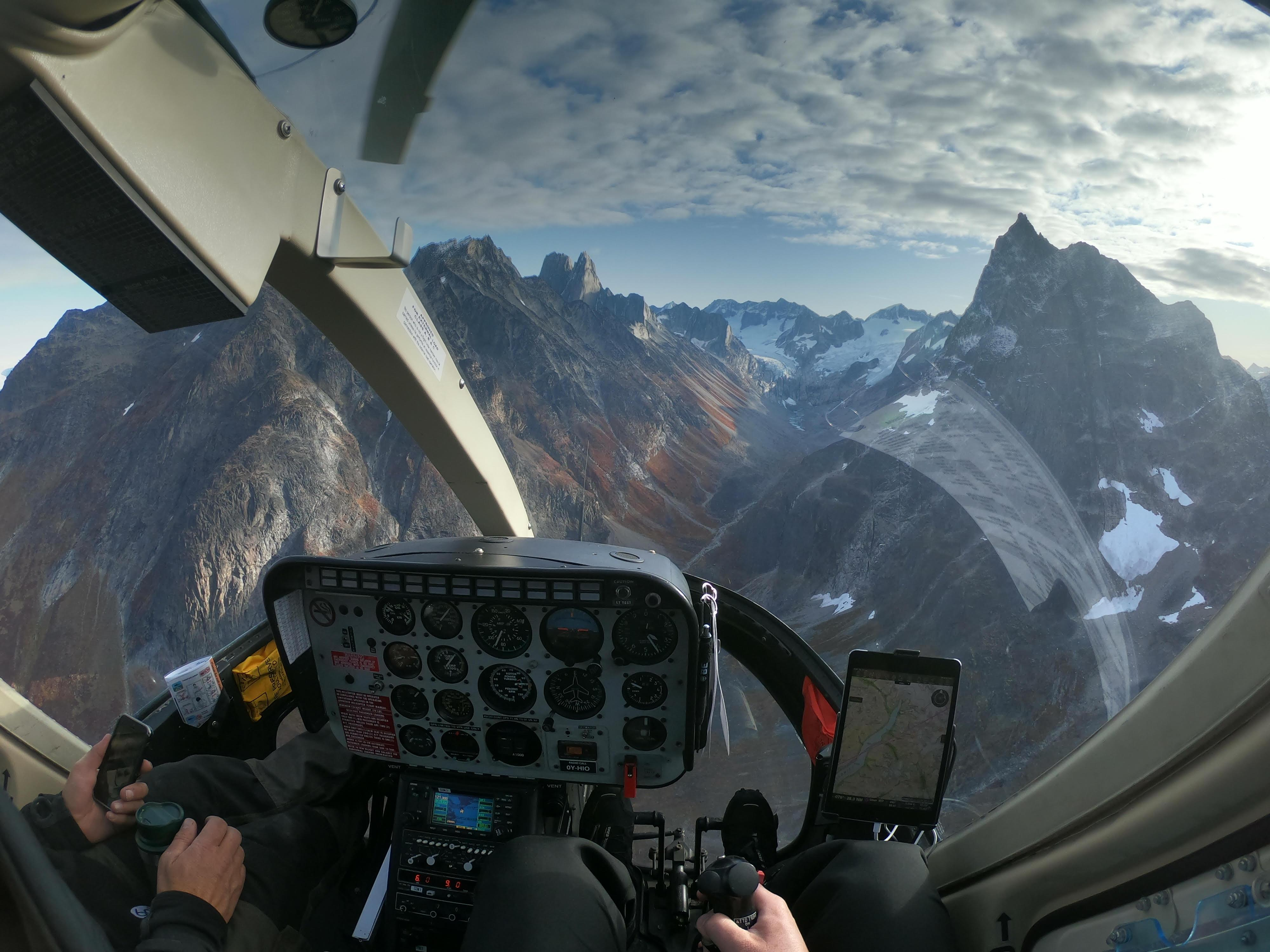 Sermeq Helicopters cockpit view of a fjord in South Greenland. Photo by Camilla Beg Christensen, Visit Greenland.