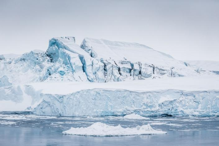 Massive iceberg grounded at the mouth of Ilulissat Icefjord. Visit Greenland