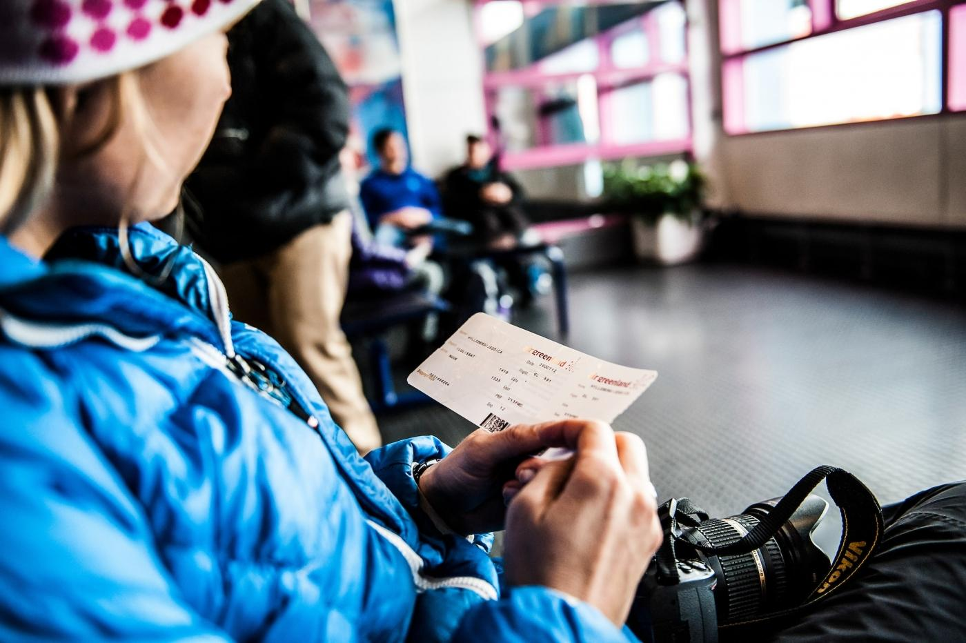 A traveler waiting to board a plane from Ilulissat in Greenland.