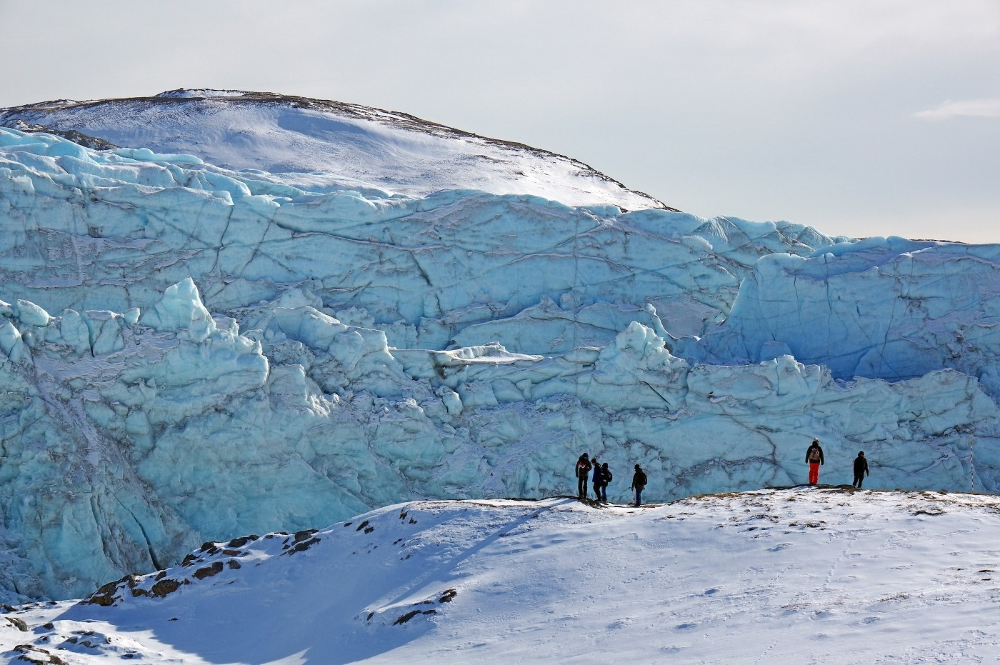 Tourists admiring the front face of Russell Glacier, close to Kangerlussuaq, on a clear winter's day. Photo by Reinhard Pantke - Visit Greenland