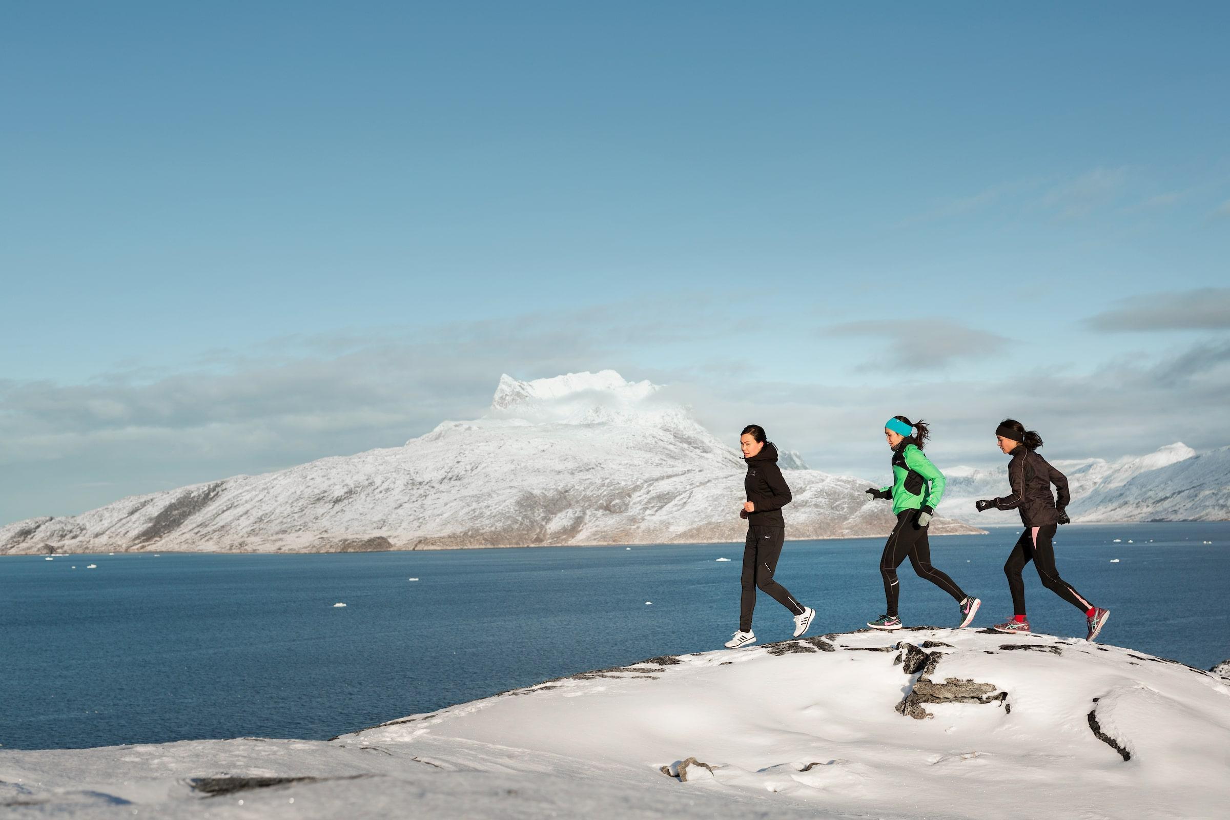 Runners near Mt Sermitisiaq, Nuuk. Photo by Rebecca Gustafsson - Visit Greenland