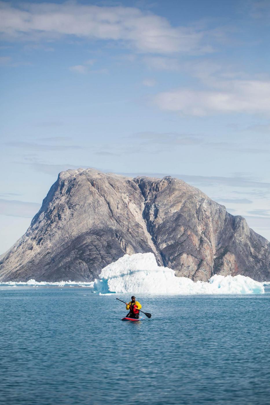 Paddle Boarding Between Icebergs. Photo - Aningaaq R. Carlsen, Visit Greenland