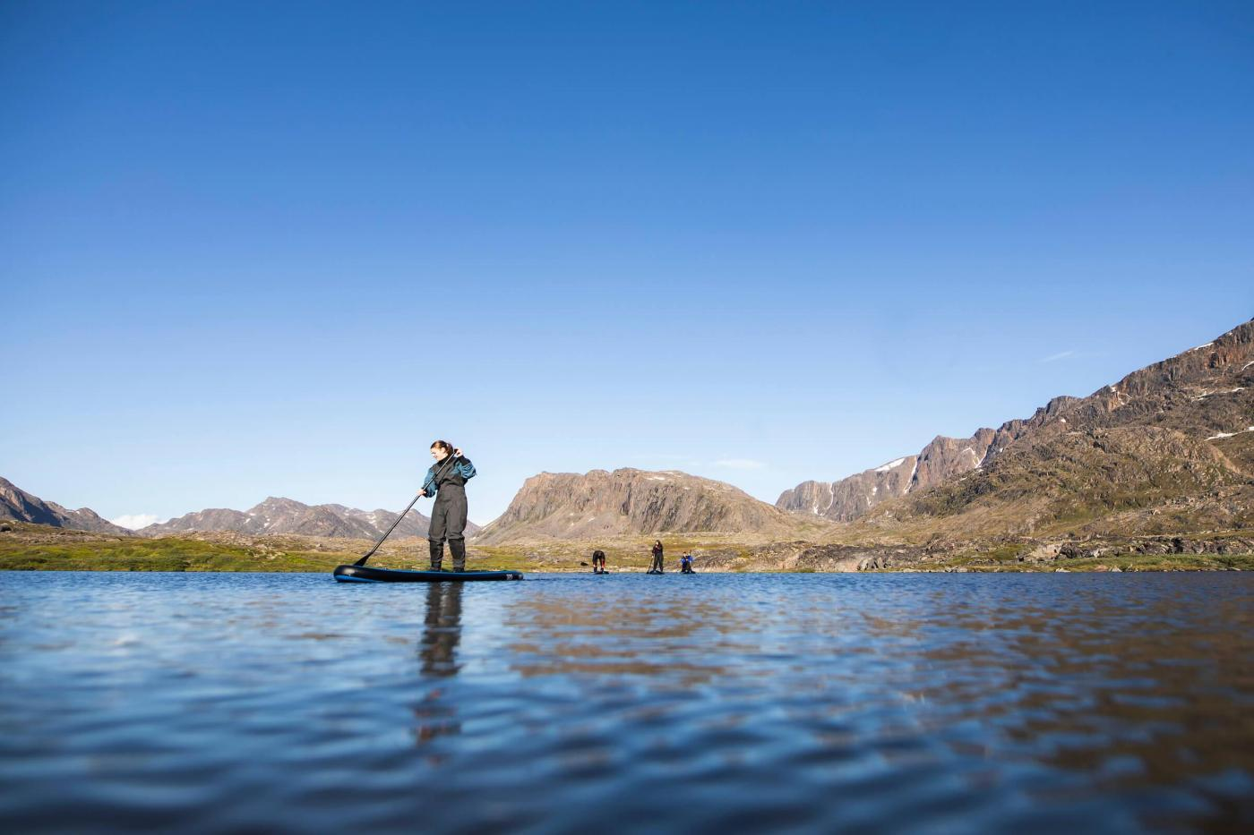 SUP in a lake in Sisimiut. Photo - Aningaaq R. Carlsen, Visit Greenland