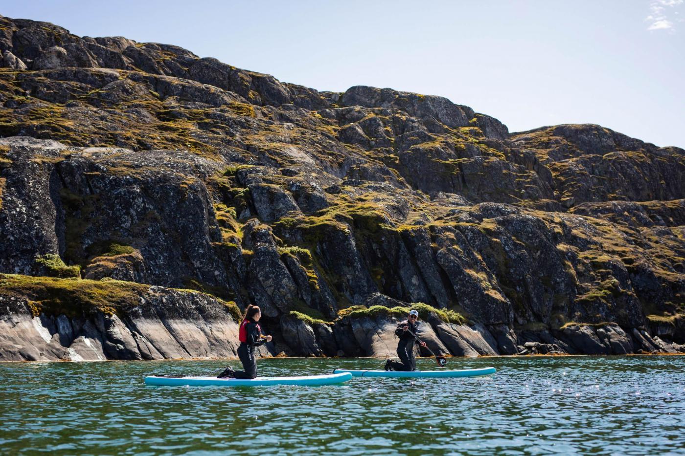 SUPs with rocky surroundings near Sisimiut. Photo - Aningaaq R. Carlsen, Visit Greenland