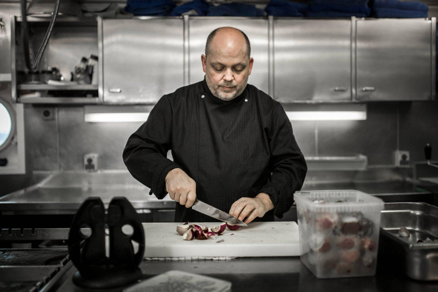 A chef on the passenger ferry Sarfaq Ittuk in Greenland. By Mads Pihl