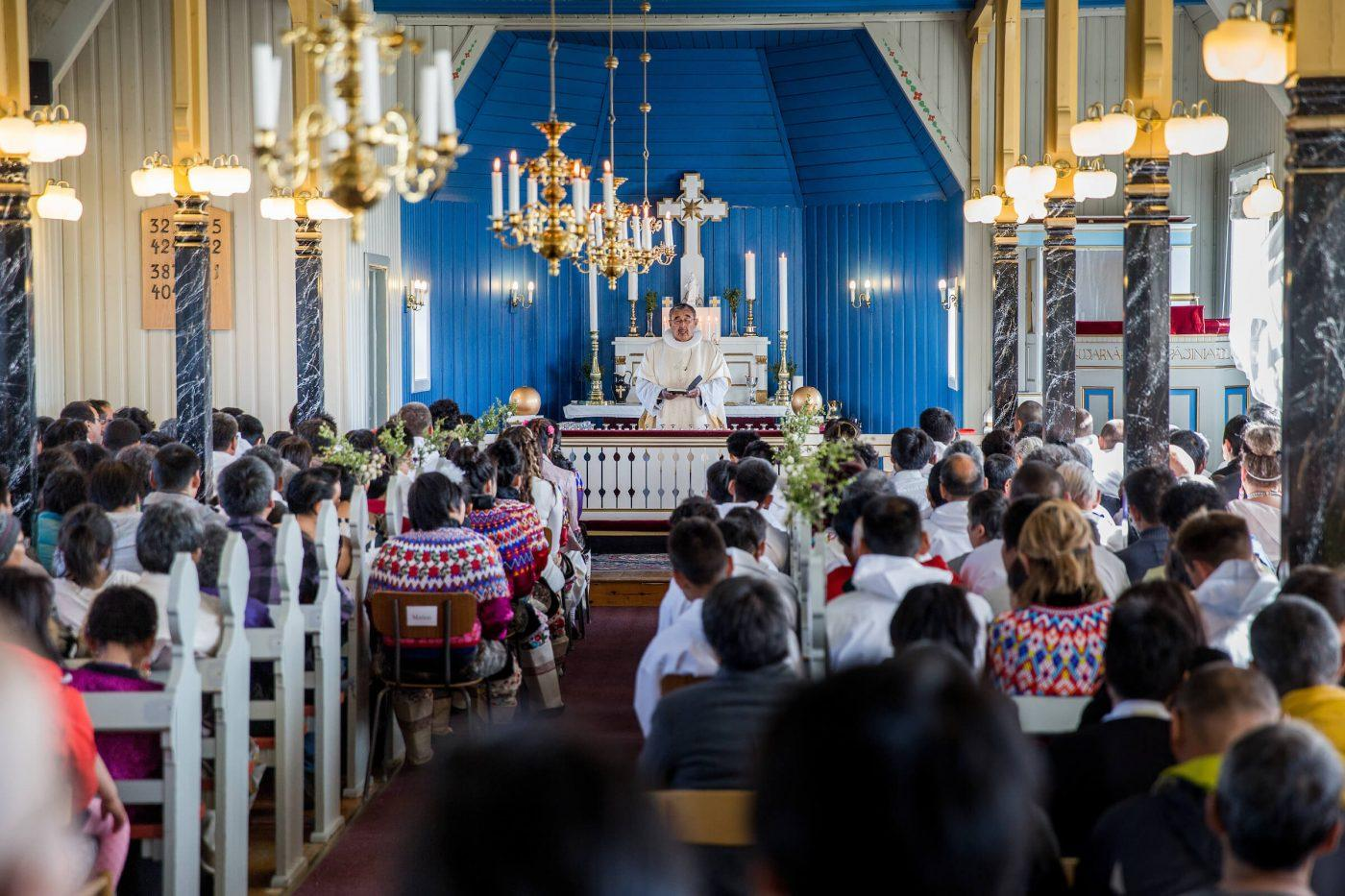 A completely packed church in Nanortalik on the day of Confirmation for the local kids, by Mads Pihl