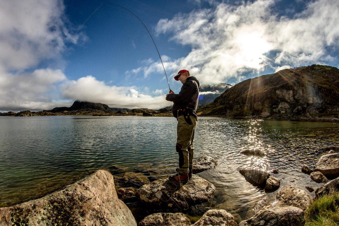 A fisherman at the shores of a lake near the river Erfalik in Greenland. By Mads Pihl