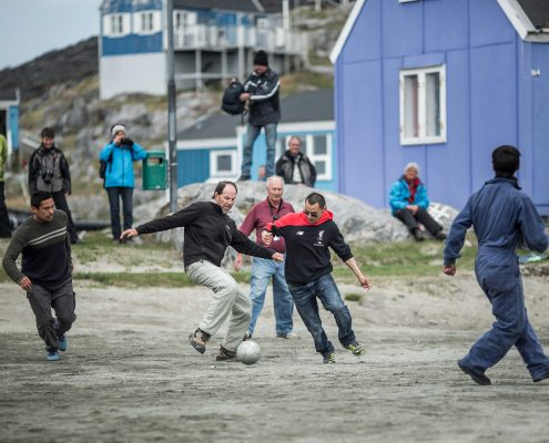 A game of soccer between cruise guests and Itilleq locals in Greenland. Photo by Mads Pihl