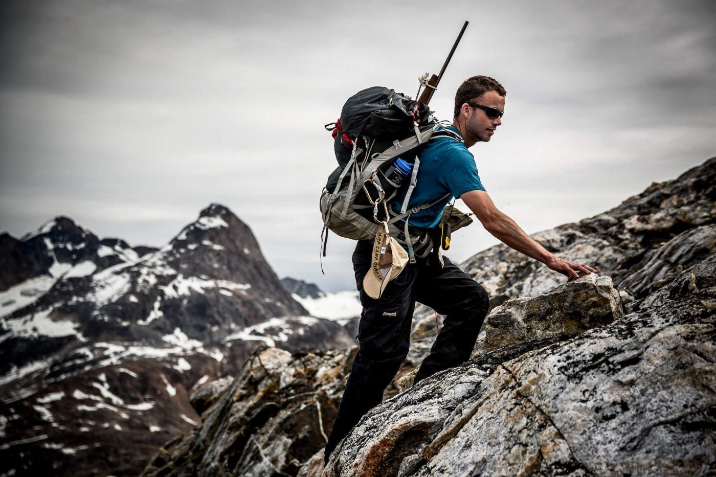 A Greenland Travel hiking guide on a trek in East Greenland near Tasiilaq. By Mads Pihl