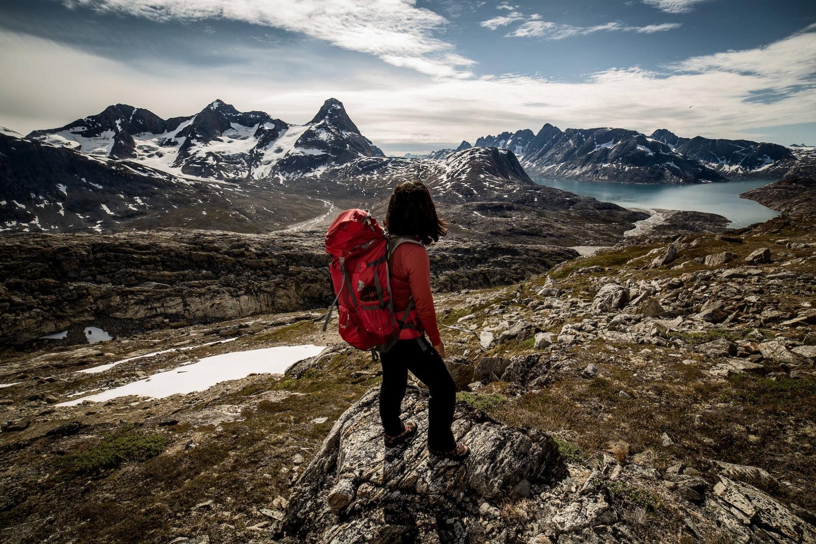 A hiker looking towards Tasiilaq Island in East Greenland