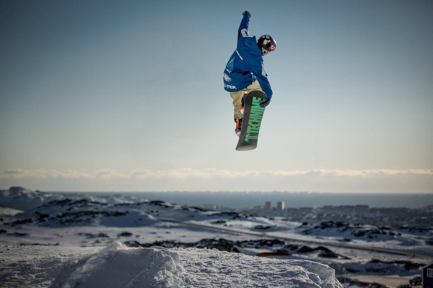 A snowboarder doing a tailgrab in Nuuk in Greenland. Photo by Mads Pihl