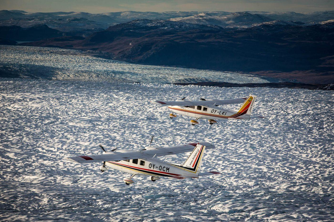 A view of two Air Zafari flightseeing planes over the Greenland Ice Sheet near Kangerlussuaq Airport. By Mads Pihl
