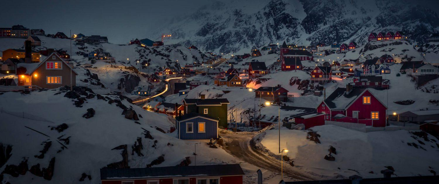 A winter nighttime view of parts of Sisimiut in Greenland. Photo by Mads Pihl
