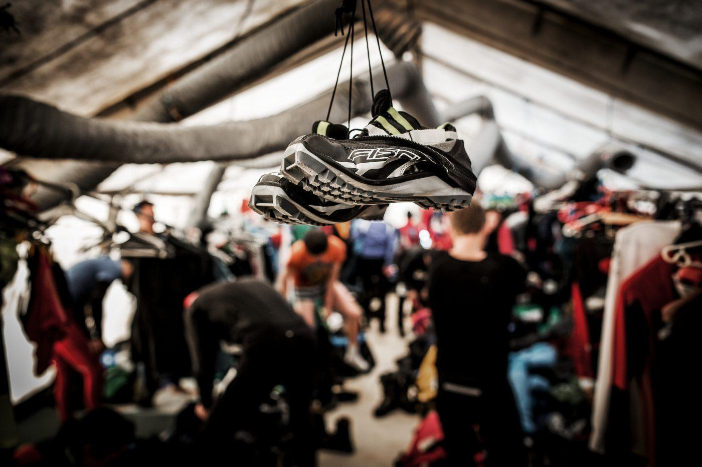 Pair of shoes waiting to be changed by a skier during Arctic Circle Race