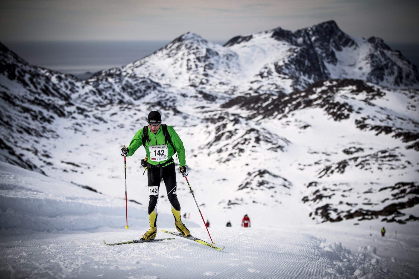 Competitor skiing uphill - Arctic Circle Race. Photo by Mads Pihl, Visit Greenland