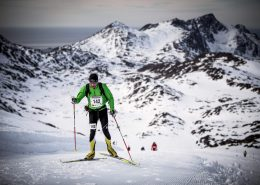 A skier climbing one of the many hills of the Arctic Circle Race