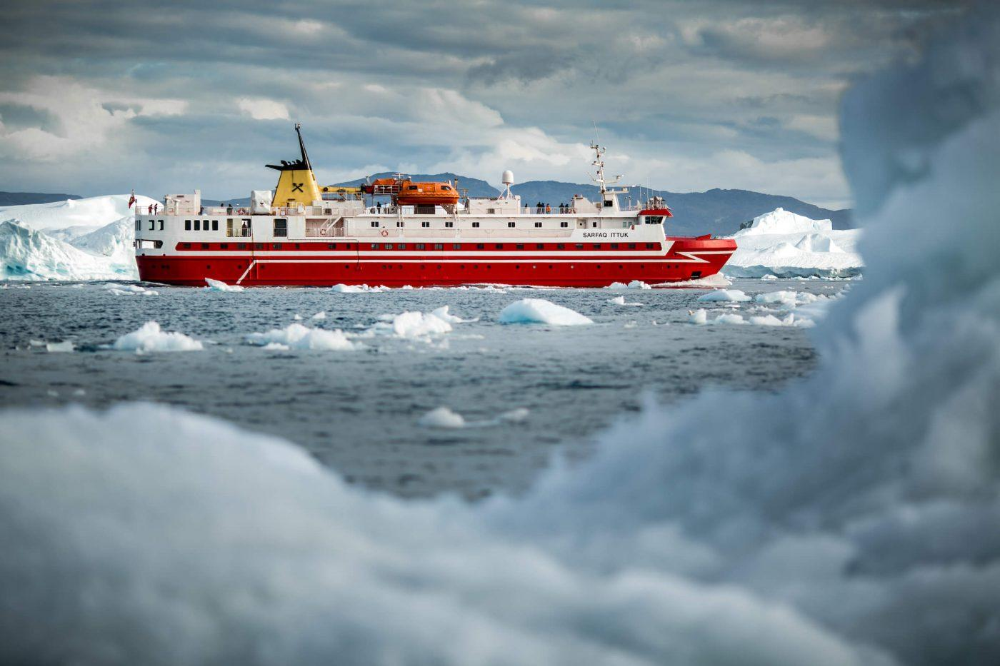 Sarfaq Ittuk cruising in the Disko Bay outside Ilulissat ice fjord in GreenlandGuests in one of the cabins in Sarfaq Ittuk. Visit Greenland
