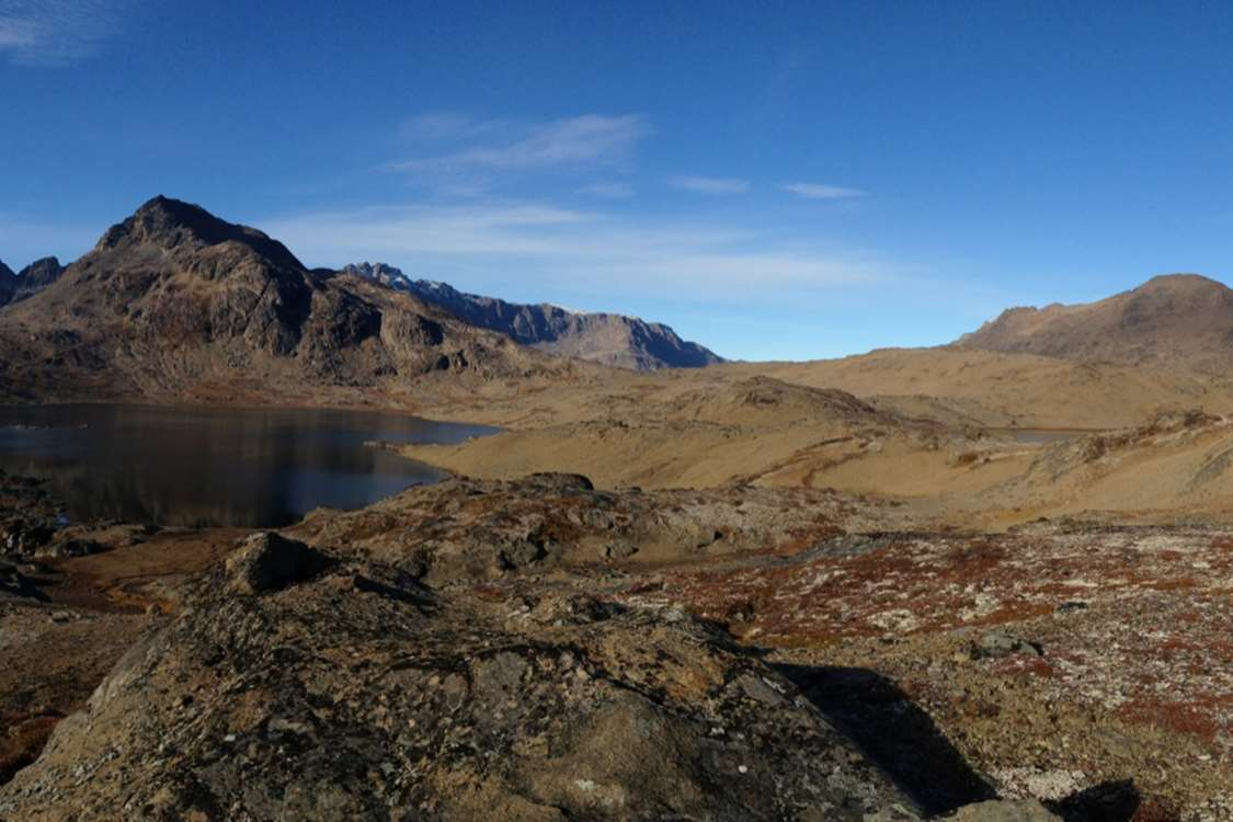Beautiful landscape in East Greenland under clear blue skies. Visit Greenland