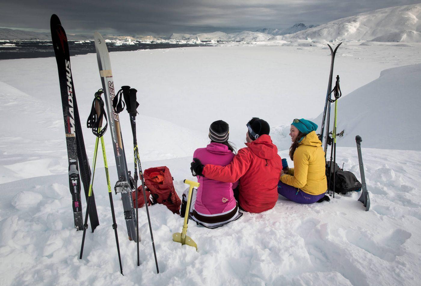 Backcountry skiers on a coffee break above Sermilik ice fjord in East Greenland