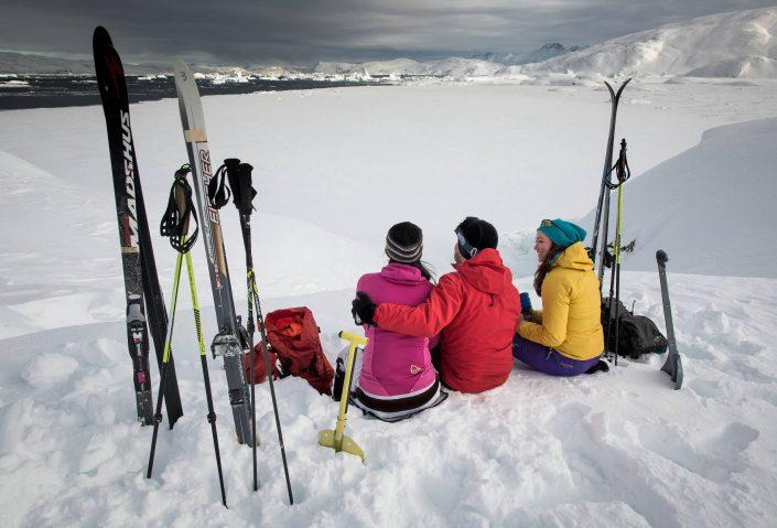 Backcountry skiers on a coffee break above Sermilik ice fjord in East Greenland