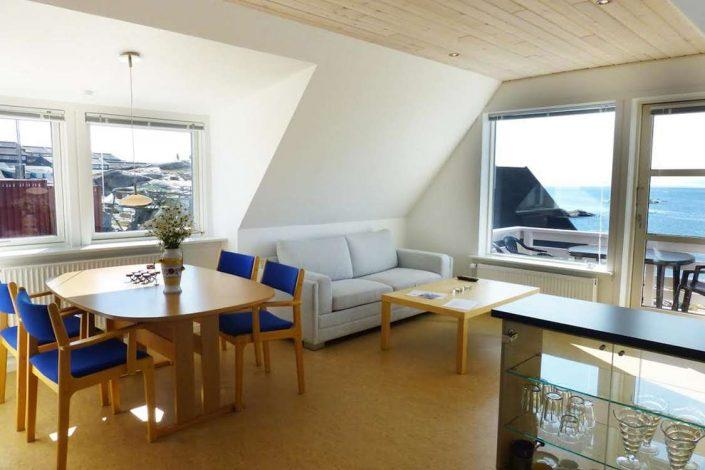Bright living area with a large balcony and view over the sea. Photo by Bed & Breakfast Paa and Jannik