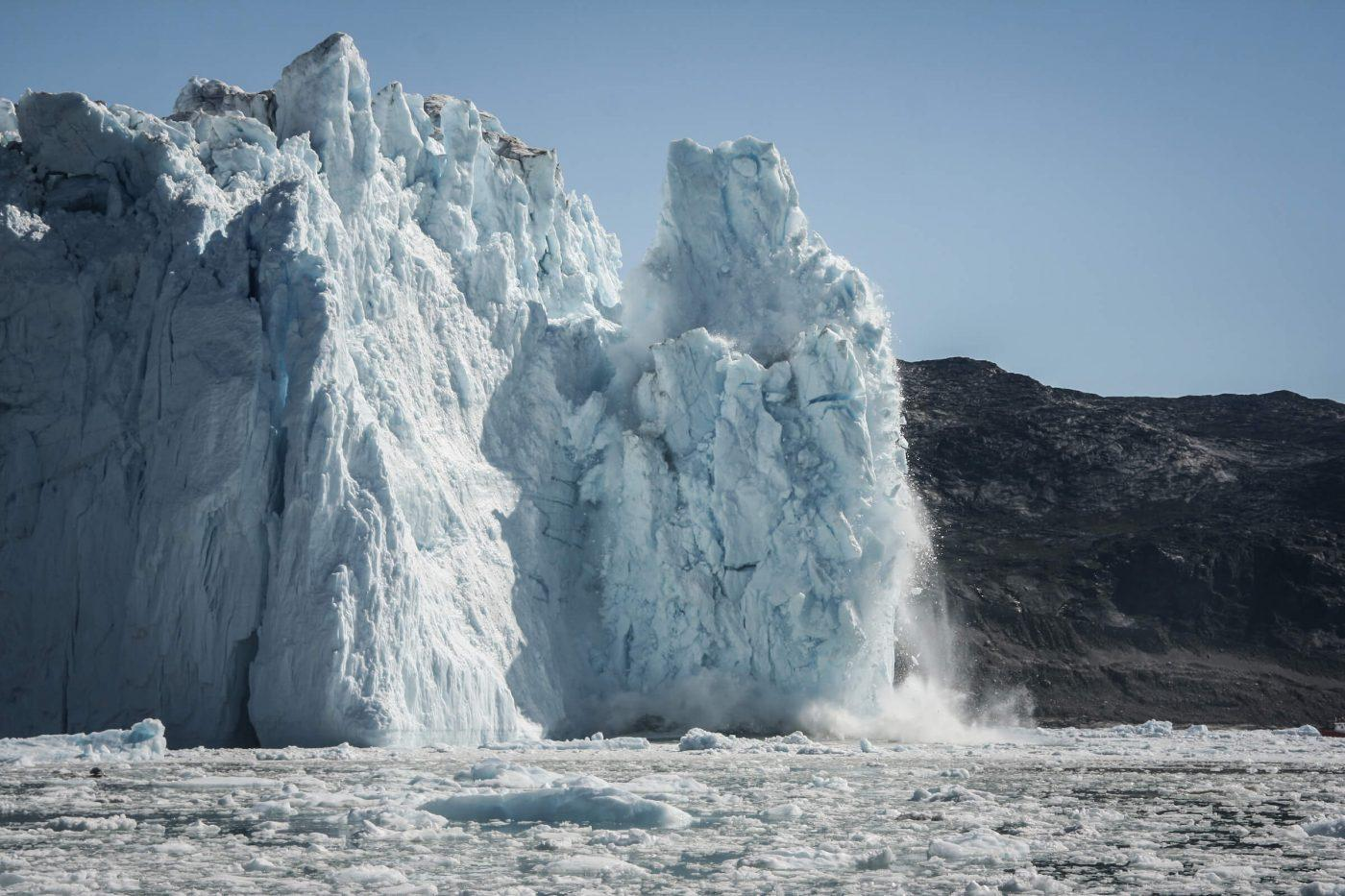 Calving glacier in Greenland, by Leif Taurer