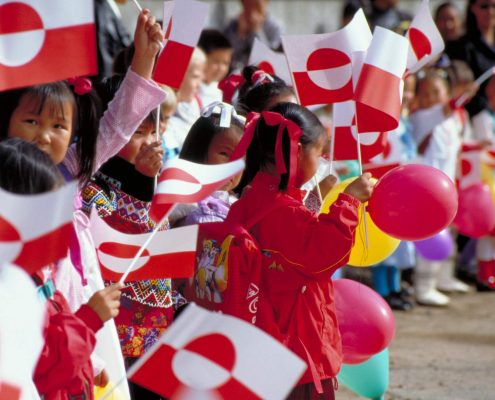 Festivals: Children with Greenland's flag in National Day, by visit Greenland