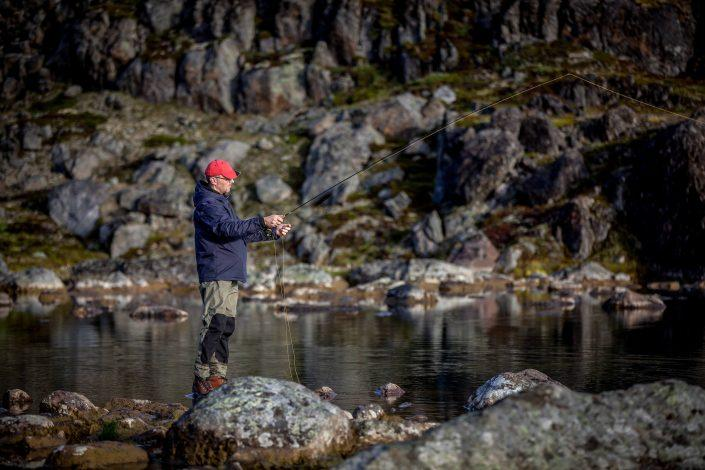 Fly fishing by a lake on the Erfalik river in Greenland. Photo by Mads Pihl