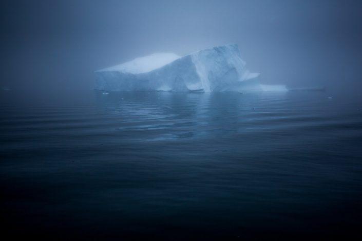 Fog around an iceberg near Ilulissat in Greenland. Photo by Mads Pihl