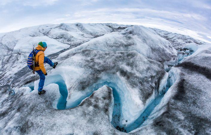 Glacier walking on the Greenland Ice Sheet near Kangerlussuaq with Albatros Arctic Circle includes hopping over a glacial river or two. By Raven Eye Photography