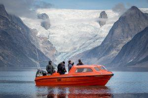 Guests on a boat tour visiting the Tasermiut fjord in South Greenland. By Mads Pihl