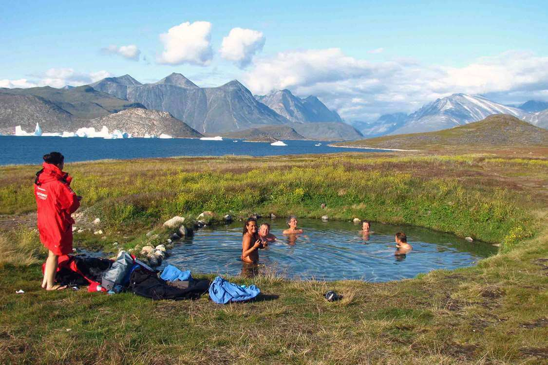Hikers relaxing at the hot springs in Uunartoq. Photo by Tasermiut South Greenland Expeditions, Visit Greenland
