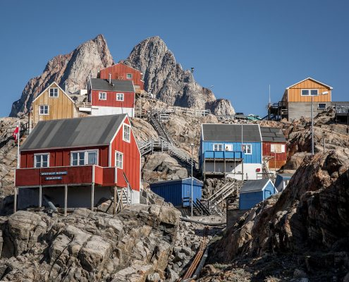 Houses on the hillside in Uummannaq in North Greenland with the prominent heat shaped mountain in the background