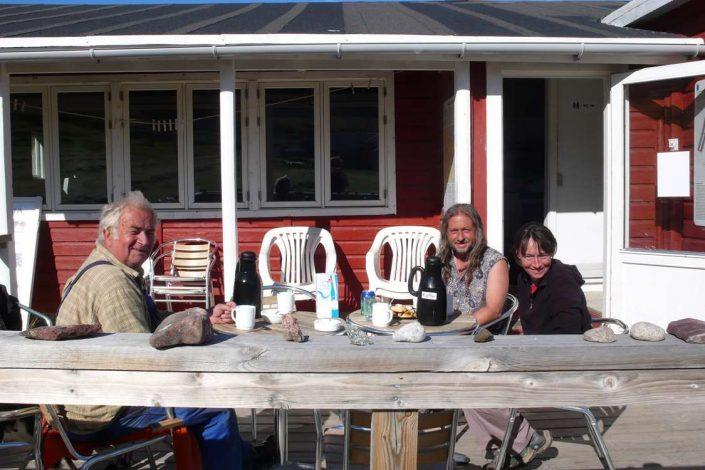 Guests enjoying their afternoon coffee on the porch at Igaliku cafe in summer. Photo by Igaliku Café - Visit Greenland