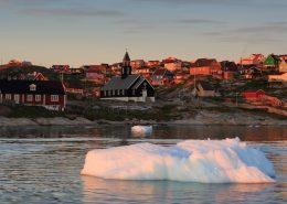 Ilulissat in midnight sun, seen from the sea, by Iurie Belegurschi