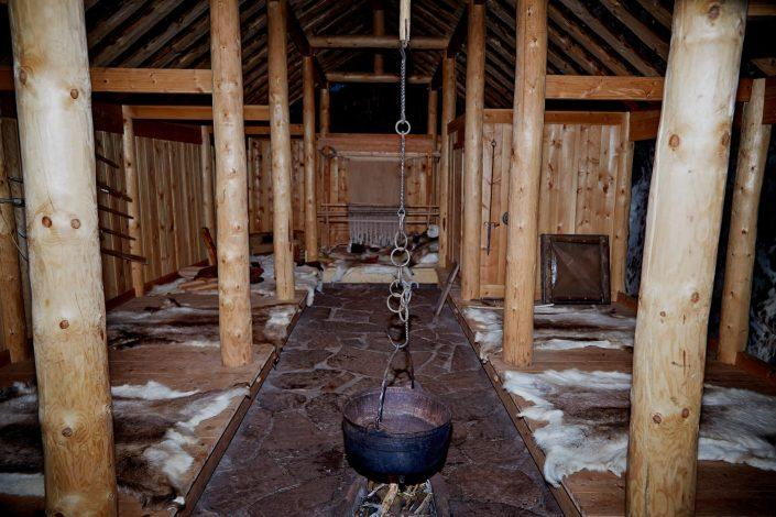 Inside the reconstructed viking longhouse in Qassiarsuk in South Greenland. By Camilla Hey